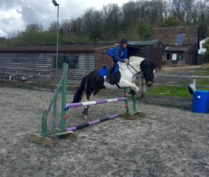 Lizzie and Mikey having a jump
